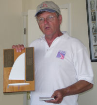 Jim accepting another race trophy, 2005 in Muskegon